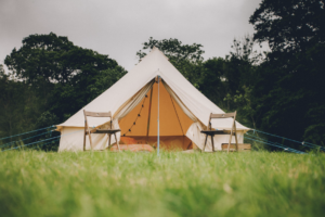 Camping chairs outside a bell tent on the Furzebrook Estate