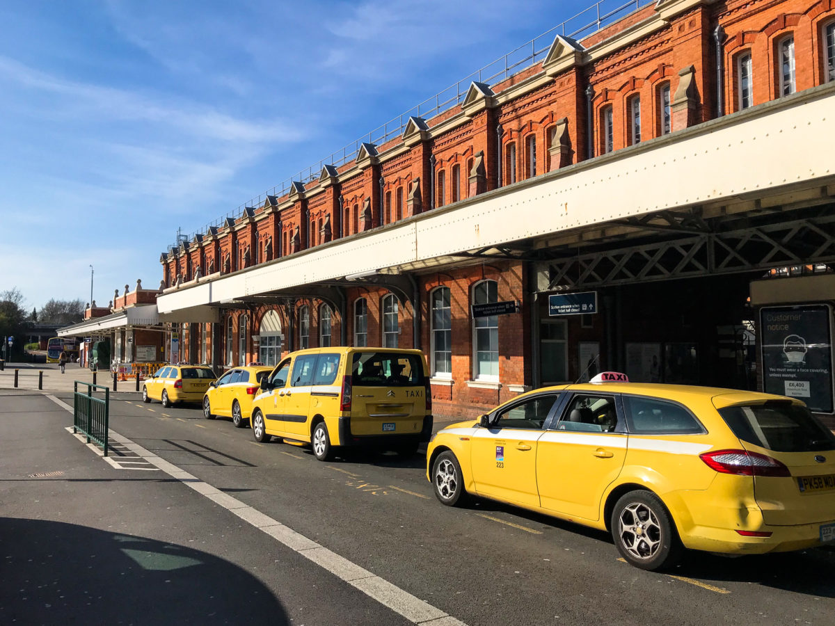 Yellow taxis outside Bournemouth Train Station