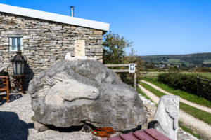 Carving of horse's head at entrance to Burngate Stone Carving Centre