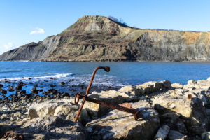 Rusted anchor on rocks at Chapman's Pool