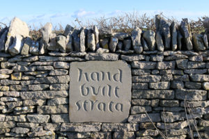 Hand Built Strata carved sign set into wall at Chapman's Pool descent
