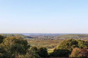 Corfe Castle and village in gap between Purbeck Hills