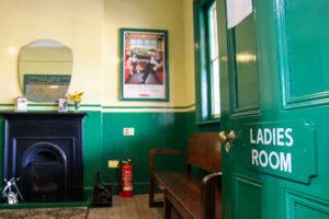 Door opening on to Corfe Castle railway station ladies waiting room