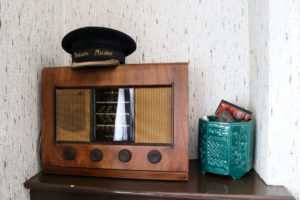 station station master's hat on vintage radio in Corfe Castle station