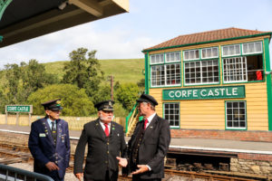 Corfe Castle railway station station volunteers standing on platform