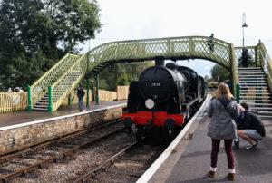 Corfe Castle station footbridge with train arriving
