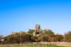 View of Corfe Castle ruin from the village cemetery