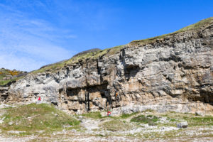 People climbing the cliffs of Dancing Ledge