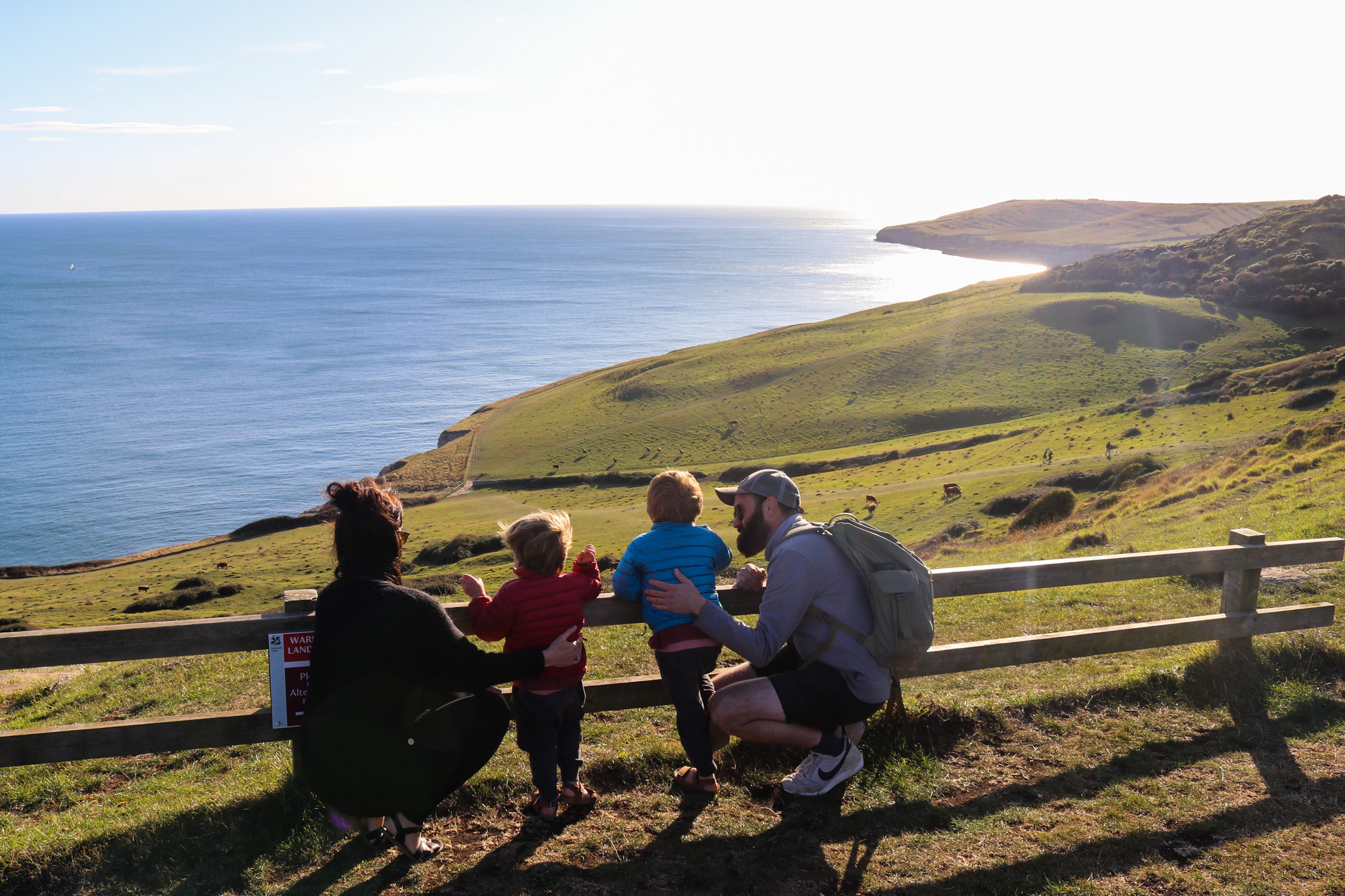 Family looking out at view at Dancing Ledge