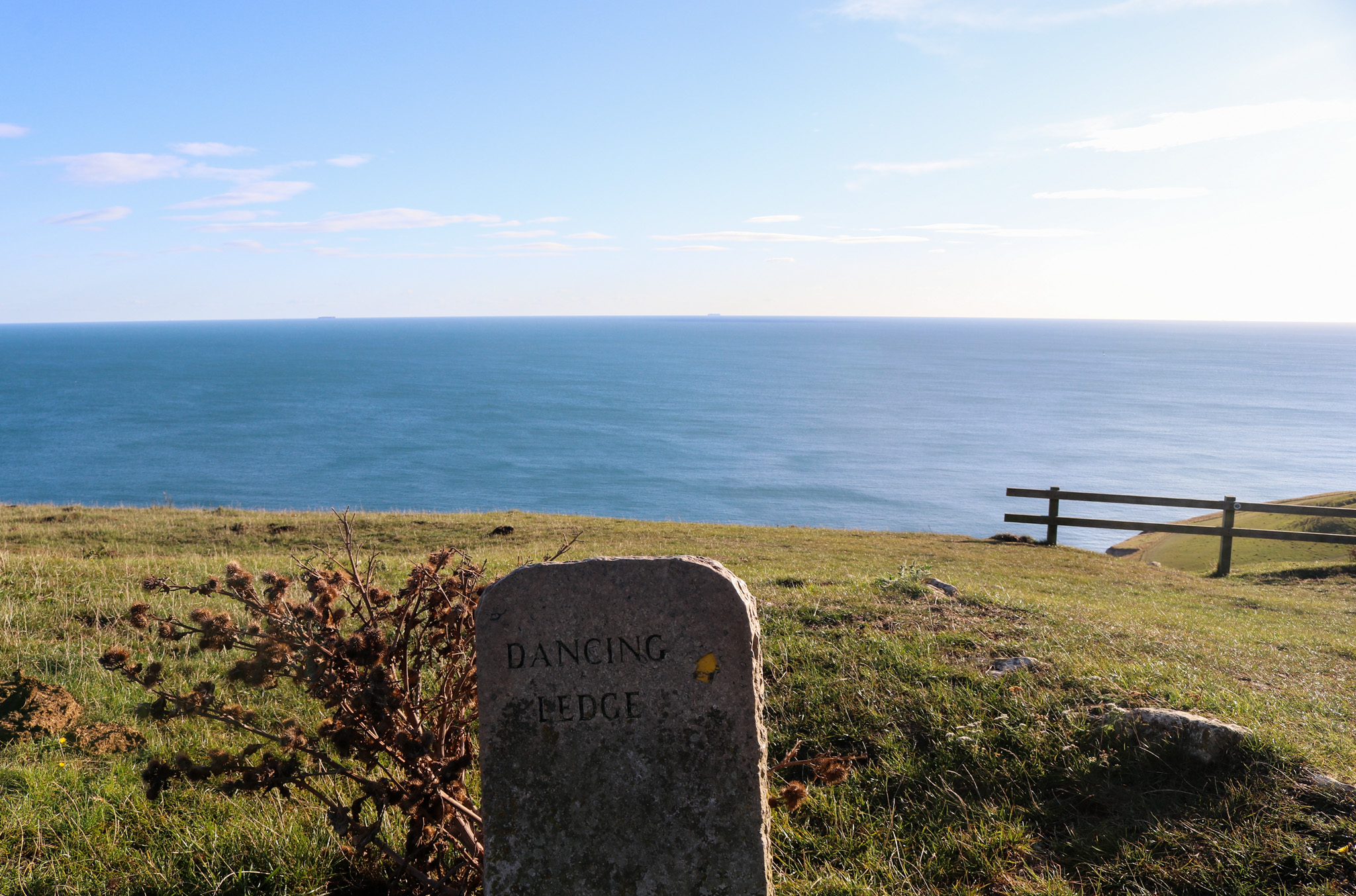 Stone sign at Dancing Ledge overlooking the sea