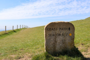 Stone sign for Seacombe and the South West Coast Path at Dancing Ledge