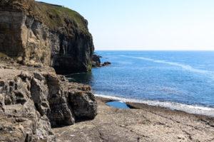 Flat rock shelf of Dancing ledge with tidal pool