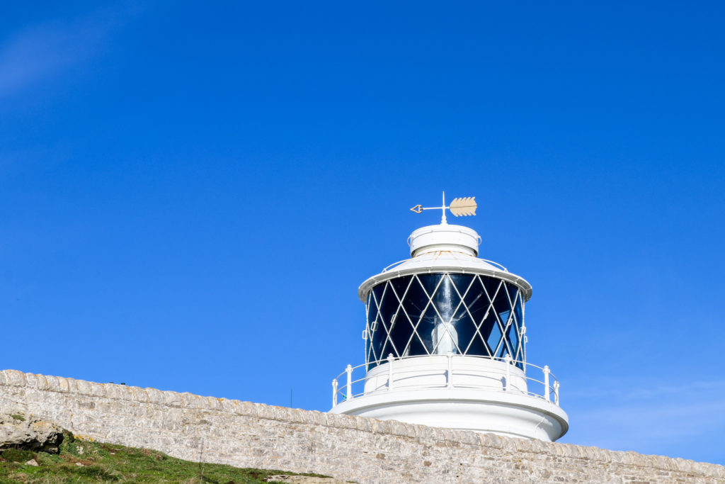 lamp and weather vane of the Anvil Point lighthouse at Durlston Country Park