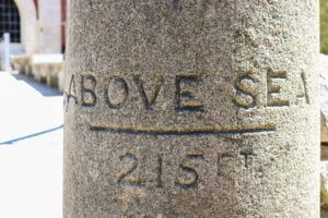 215 ft above sea sign carved into stone pillar at Durlston Castle