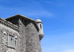 Durlston Castle's turret and sundial set into the wall
