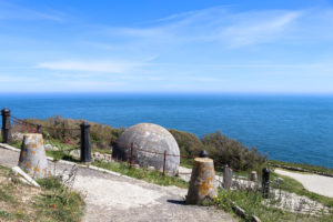 Durlston's globe viewed from the path by Durlston Castle