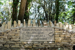 Durlston Head and Castle sign set into dry stone wall