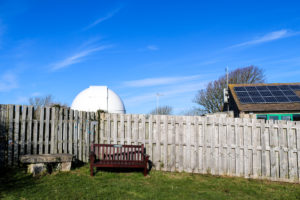Observatory behind fence at Durlston country park