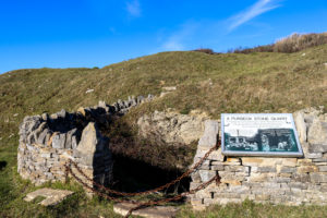 Purbeck stone quarr and information board at Durlston Country Park