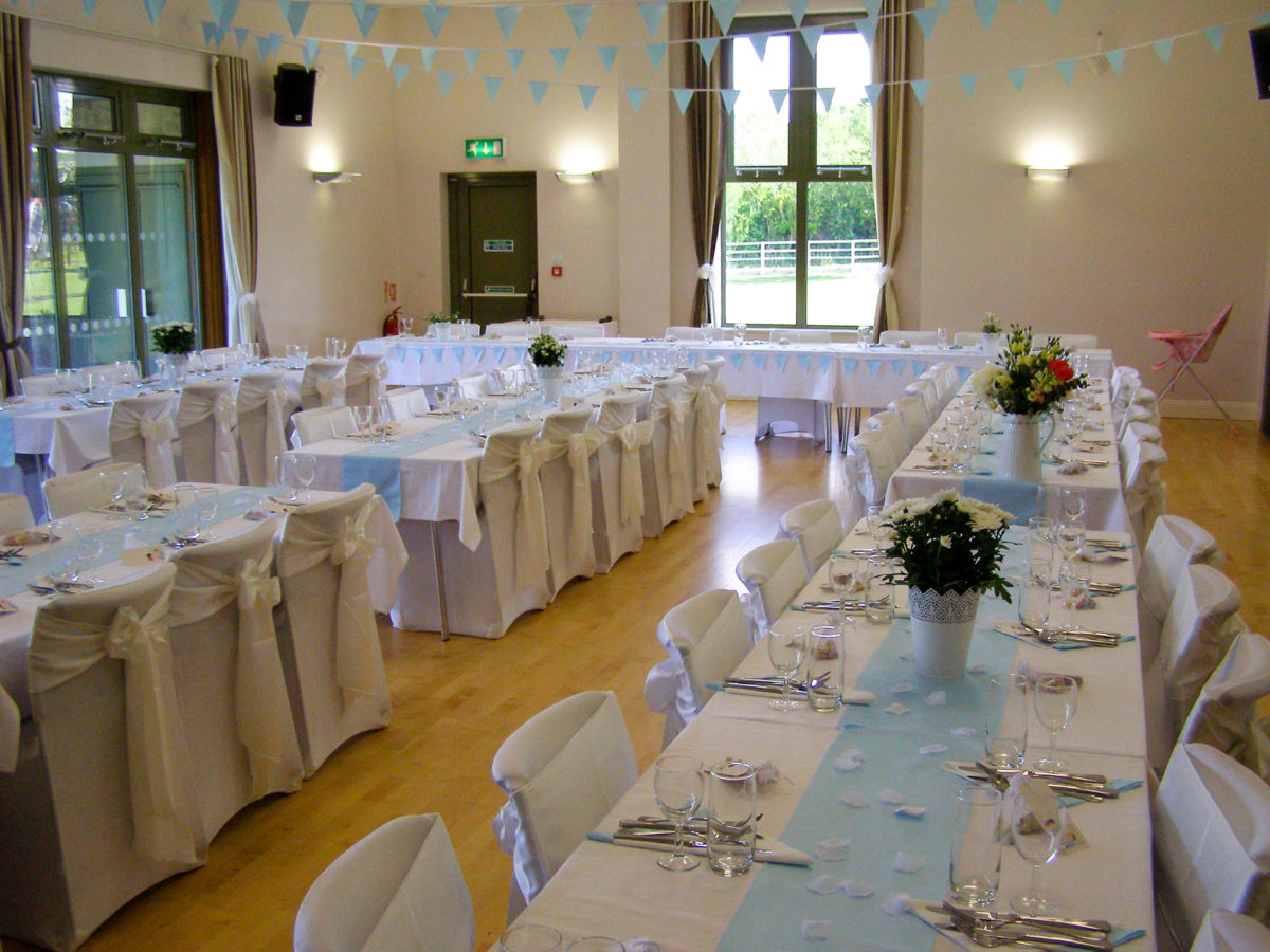 Wedding tables set for guests at Harman's Cross village hall