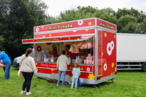 People buying candy floss at the Harman's Cross show