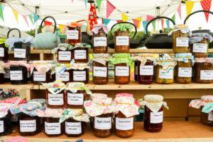 Jars of handmade jams, marmalade and chutney for sale at the Harman's Cross Fayre