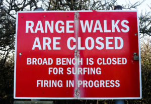 Sign at Kimmeridge Bay warning that Range Walks and Broach Bench are closed
