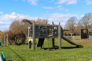 Dinosaur-shaped climbing frame at King George's playground, Swanage