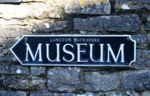 Sign for Langton Museum on the wall of St George's Close