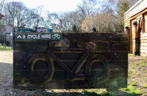 Wooden sign at Norden station's Cycle Experience
