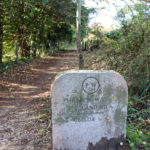 Purbeck Way stone marker at the foot of the hill path to the obelisk in Swanage