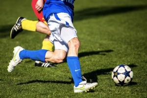 Football player kicking a ball