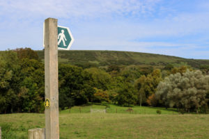 Walking sign in front of Purbeck Hills