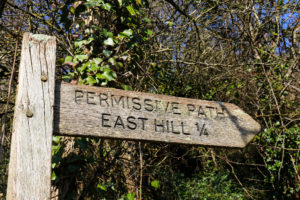 East Hill permissive path sign for the Purbeck Hills in Corfe Castle