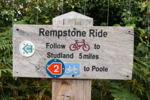 Signpost for Rempstone Ride route on the road toward Arne