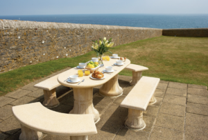 Outside seating area at Durlston's Anvil Point cottages