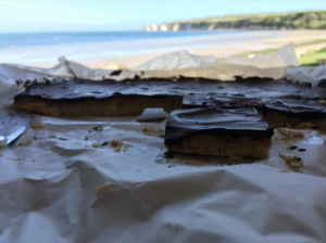 Chocolate Brownie with Old Harry Rocks in the background on South Beach Studland