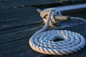 White rope tied to a wooden jetty