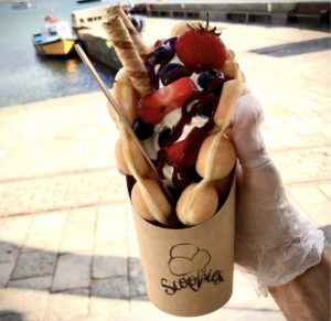 Strawberries and chocolate sauce wrapped in a bubble waffle