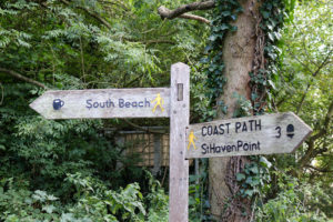 South beach and coast path wooden sign in Studland