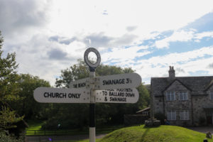 Studland signage for its church, Swanage and Ballard Down