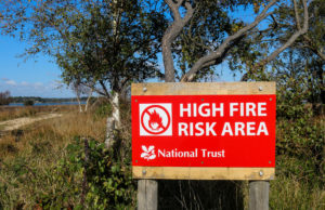 National Trust High fire risk sign along Ferry Road in Studland