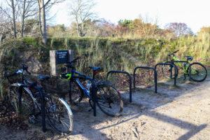 Bikes secured to racks at Studland's Knoll Beach