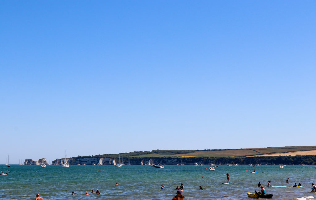 People in the sea at Knoll Beach in Studland
