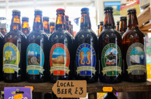 Bottles of beer on a shelf in Studland shop