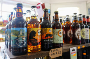 Jurassic-themed ciders on a shelf in Studland Stores