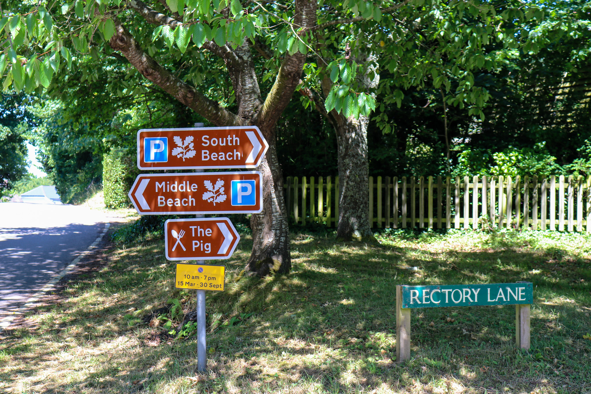 Signs for the beach on Rectory Lane in Studland