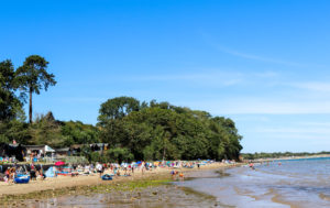 People on South Beach, Studland in summer