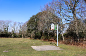 Basketball net in Studland village playground