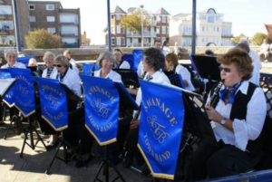 Ladies of the Swanage Town Band playing clarinets